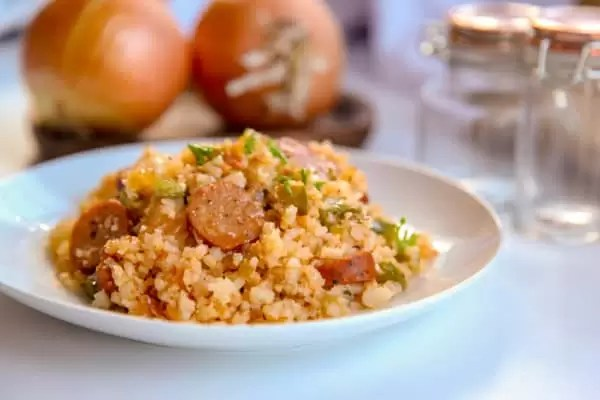 This cajun cauliflower rice is a paleo, whole30, and keto take on dirty rice. It uses riced cauliflower, andouille sausage, pepper, onion and creole and cajun seasonings to make an easy one pot skillet meal. #whole30 #paleo #keto