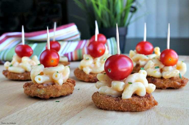 This Ultimate Fried Pickles recipe is the appetizer of your dreams - fried pickles topped with creamy 5-ingredient mac and cheese and a juicy cherry tomato.