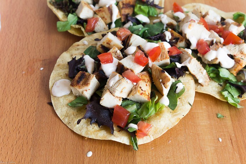 These globally-inspired, sweet and spicy Harissa Honey Chicken Tostadas are going to be your new favorite taco fusion dish.