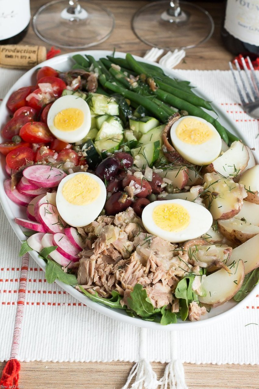Enjoy eating a delicious lunch on relaxing summer days when you create this Classic Salade Niçoise Recipe paired with your favorite French wine.
