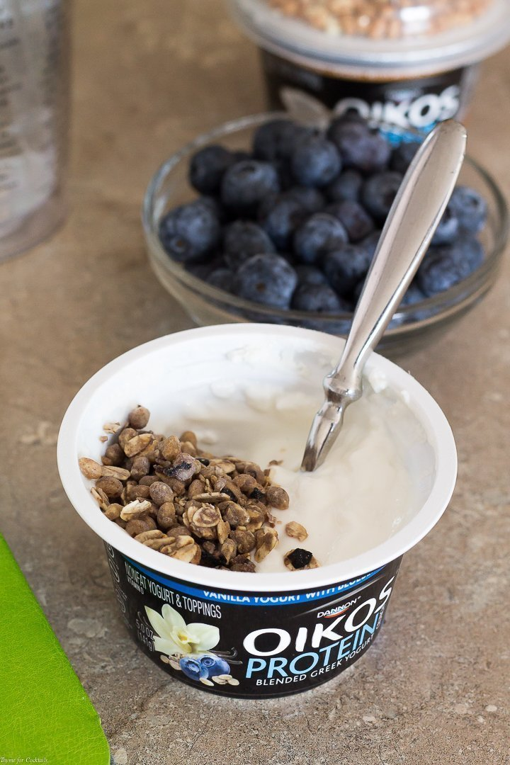close up of an opened container of Oikos® Protein Crunch Yogurt for 21 Day Protein Crunch Challenge