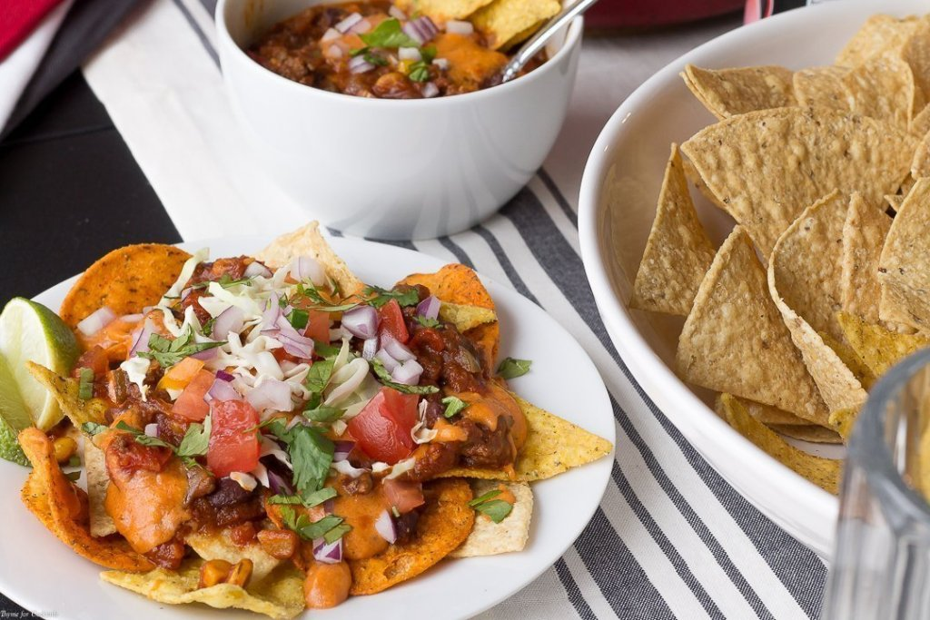 Let your competitive spirit shine when you surprise guests with thisTex Mex Chili Cheese Nacho Bar for your halftime party spread. The 3 Cheese Queso is a real winner too!