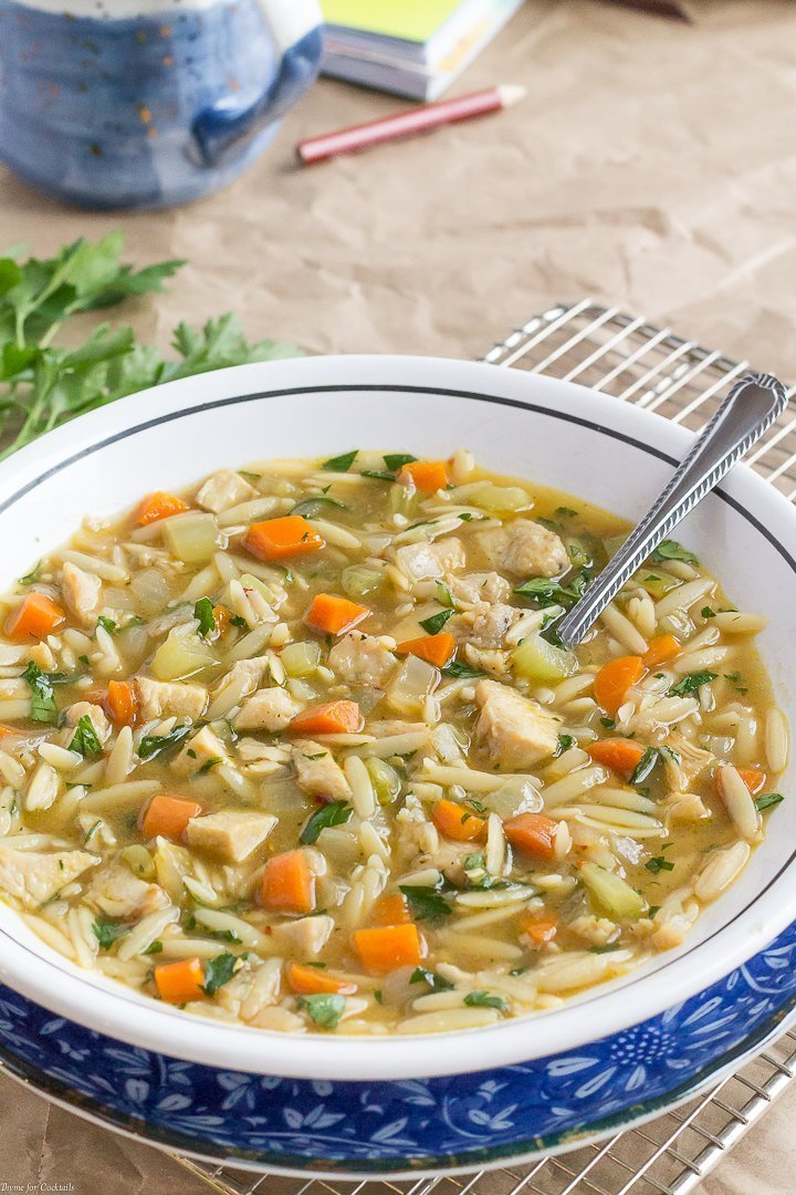 bowl of easy 20-Minute Chicken Orzo Soup with a mug of coffee