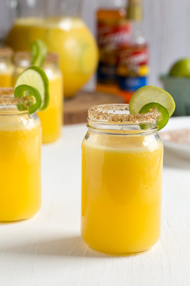 When the sun is shining, the weekend is near and you want to be the life of the party. Make a refreshing batch of light, flavorful Sparkling Mango Jalapeno Margarita Punch full of sweet heat!