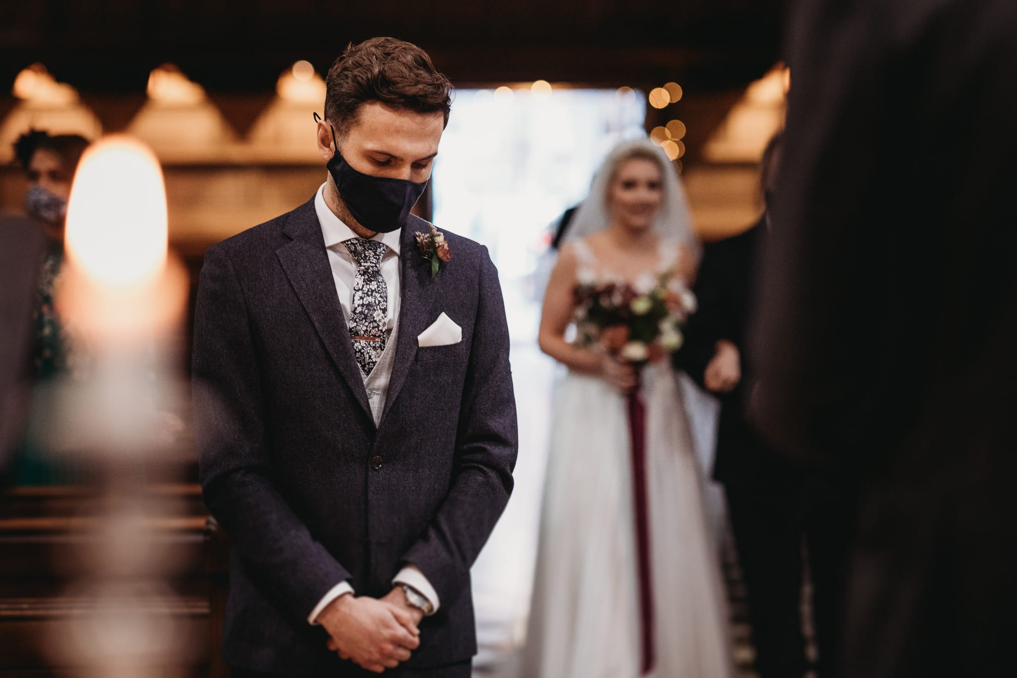 groom wearing mask, bride walking with her father