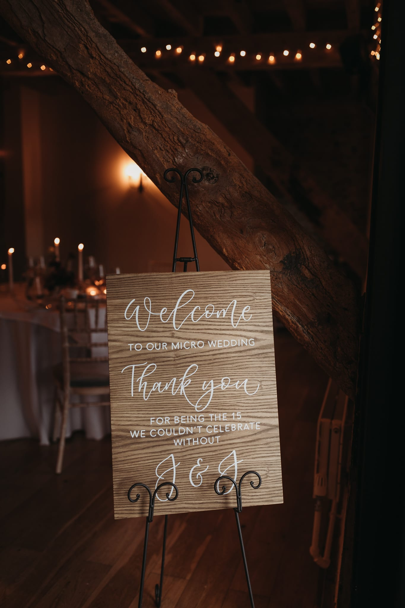wedding welcome sign with warm lights in background Granary Estates Intimate wedding