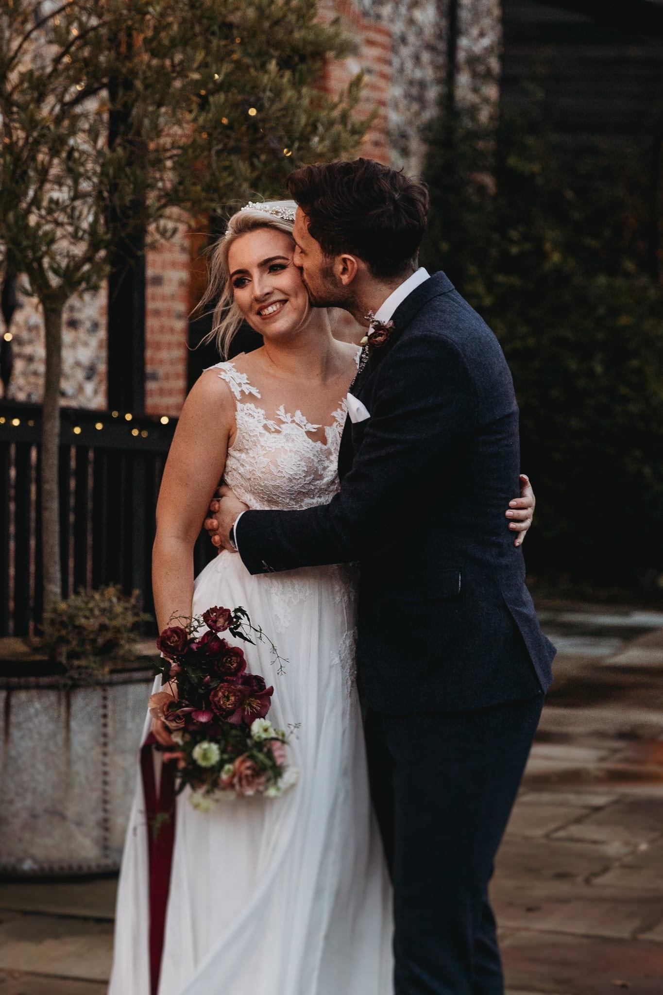 groom kissing bride's face at Granary Estates Intimate wedding