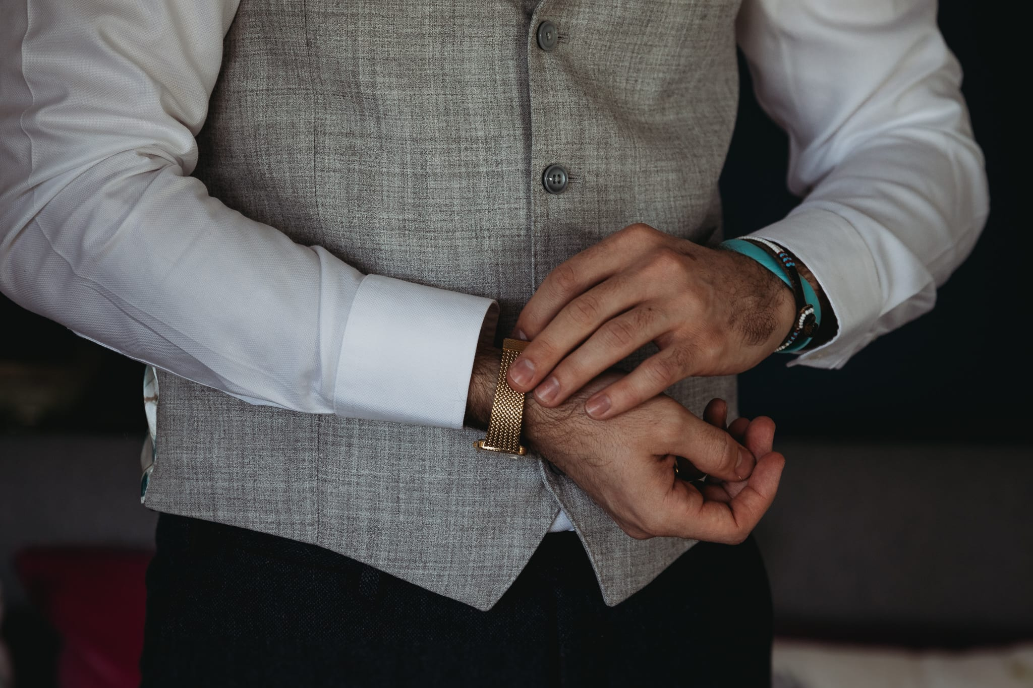 closeup of man putting his watch on