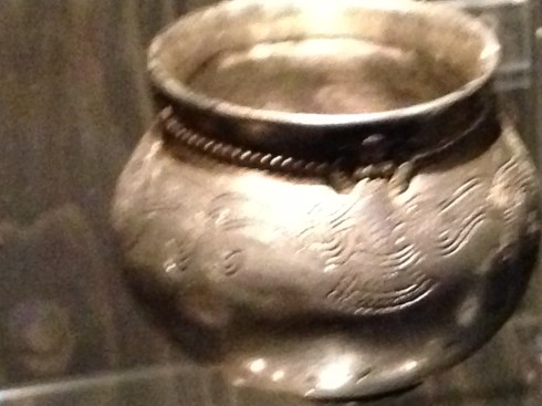 Silver cup with the figure of a woman. From Lejre, Denmark around 900s.