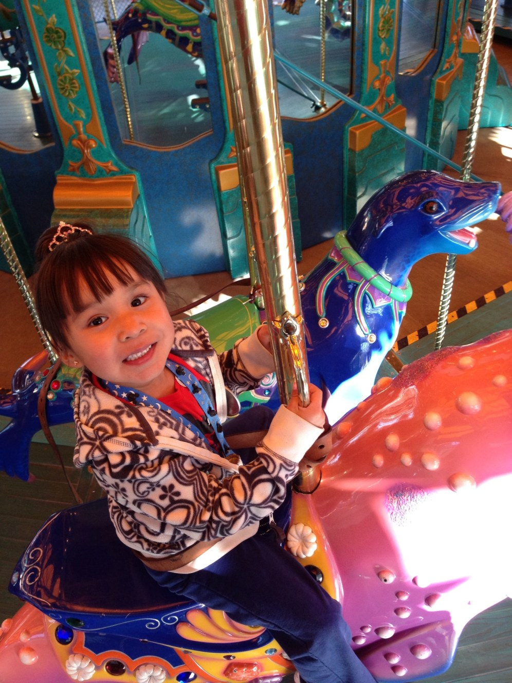 While we were in 45 minute line for Toy Story Mania, the Iz went on King Triton's Carosel
