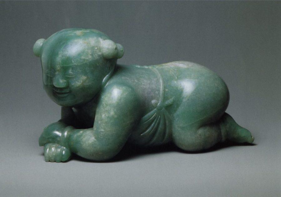 Oreiller en forme de petit garçon, jade, dynastie Qing (1644-1911)