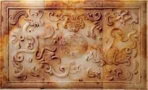 Plaque en quatre sections avec les animaux des quatre directions, dynastie Han