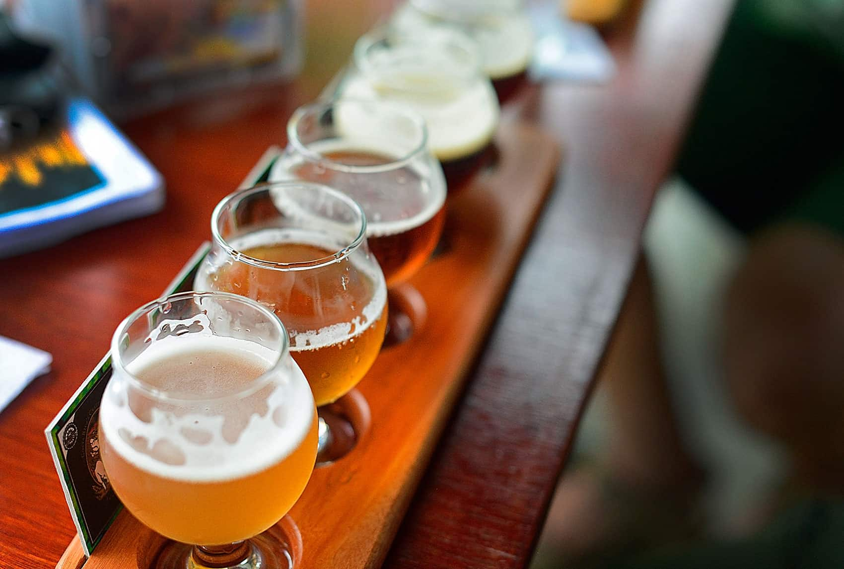 hight resolution of a flight of beer samples sits on a table at costa rica s craft brewing company s brewpub la planta lindsay fendt the tico times