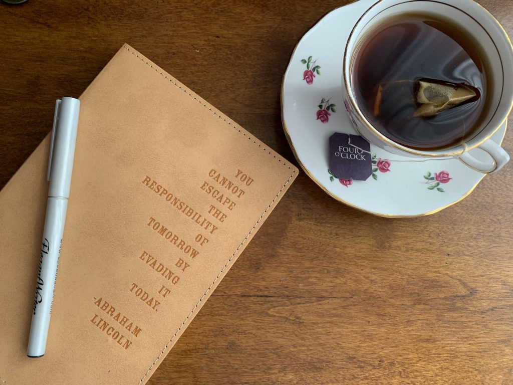photo of journal with teacup