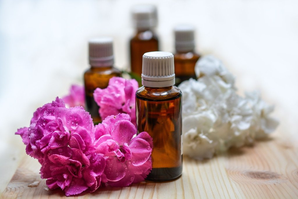 essential oil bottles with flowers photo