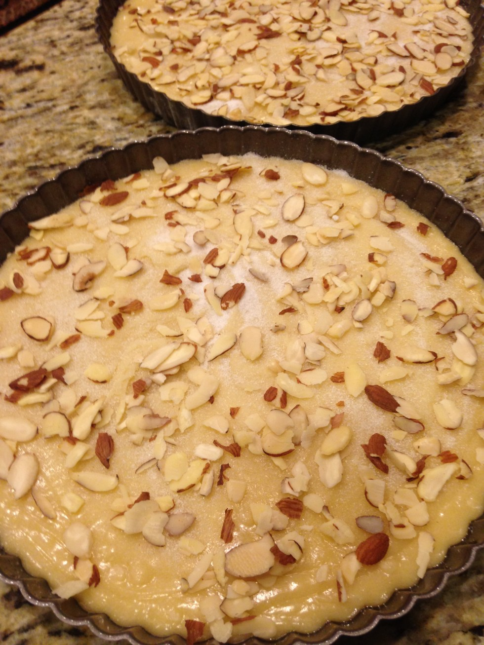 Ready for oven all sprinkled with sugar and almonds