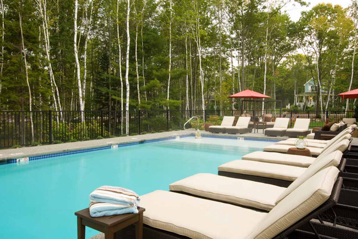 Pool at Hidden Pond with chaise lounge chairs