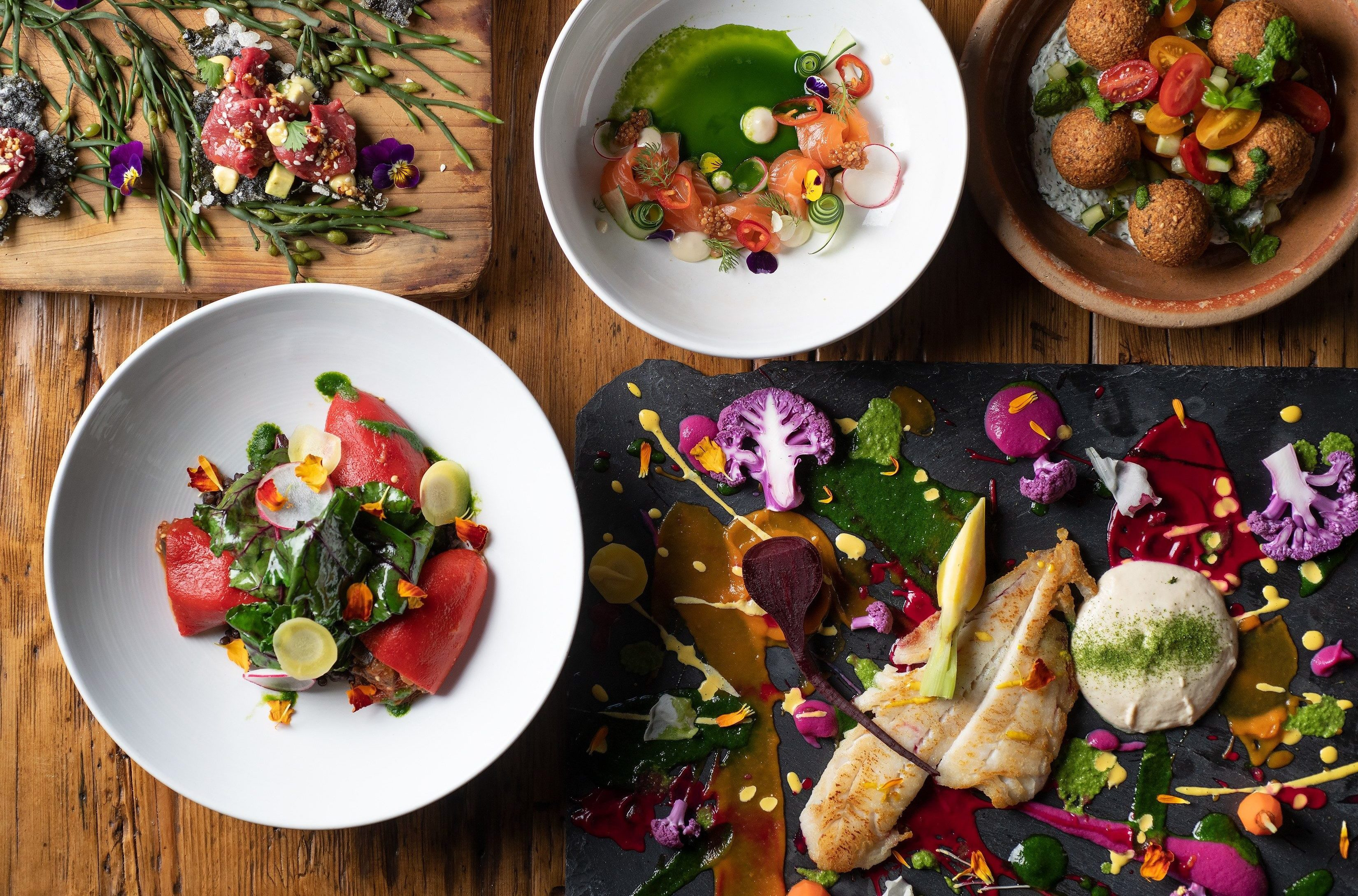 Colorful Plates of food on table