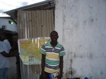 Emmanuel, my running buddy, with map of 'Mama' Liberia