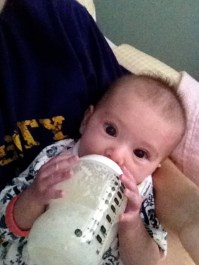 Holding her bottle. This started about a week ago! Ahhh! Slow down girlie!!