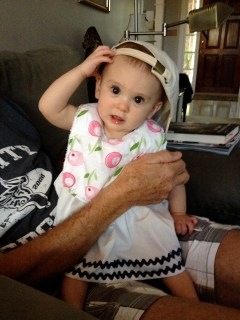 Wearing Pops' hat.