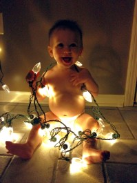 Helping put the Christmas lights on the house!