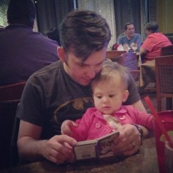 Reading with Dada at dinner.