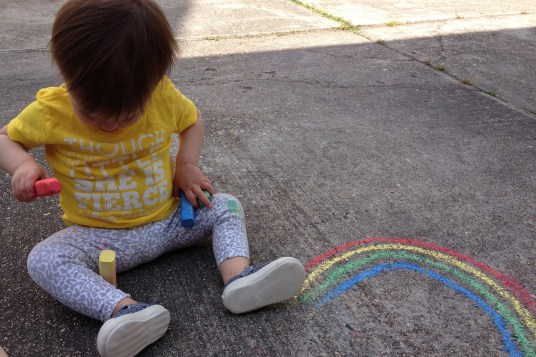 Playing with chalk for the first time.