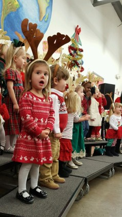 Her school Christmas Program. C sang in English, Spanish, and French!