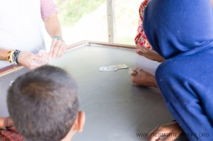 "Teaching the classic card game ""War"" on a Nepali hillside"