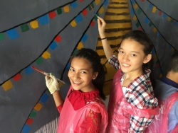 Students painting the thank you wall at Bhassars Secondary School.
