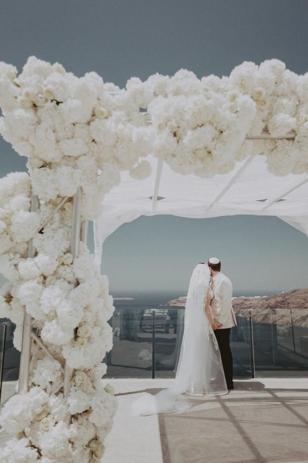 Glamorous destination wedding in Santorini Greece followed by a cruise in Italy Tie the knot