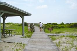 Josh heads down the bridge toward the beach. Bridges for days.