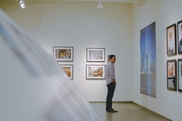 Josh looks at the 9/11 tribute photo in the museum.