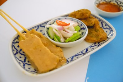 Chicken satay, pickled vegetables, & fish cake.