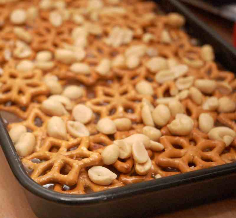 Pretzel and Peanuts on a layer of chocolate in a tray