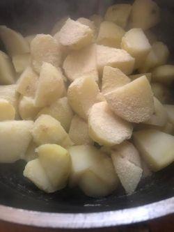 Boiled potatoes in pot with semolina