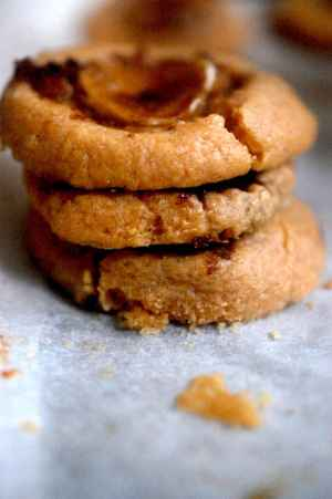 Peanut butter cookies in a pile on baking paper