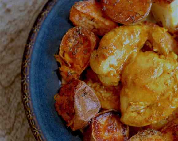 turmeric chicken and sweet potato in bowl on table