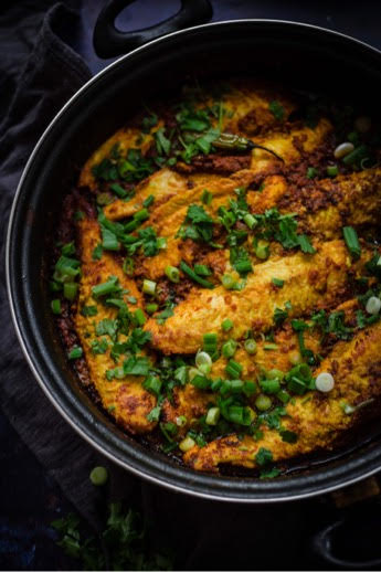 Masala Fish in pan with coriander and spring onion