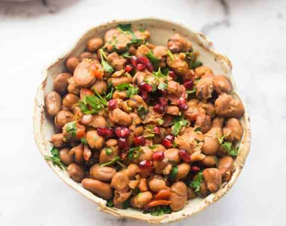 Medames and pomegranate in bowl