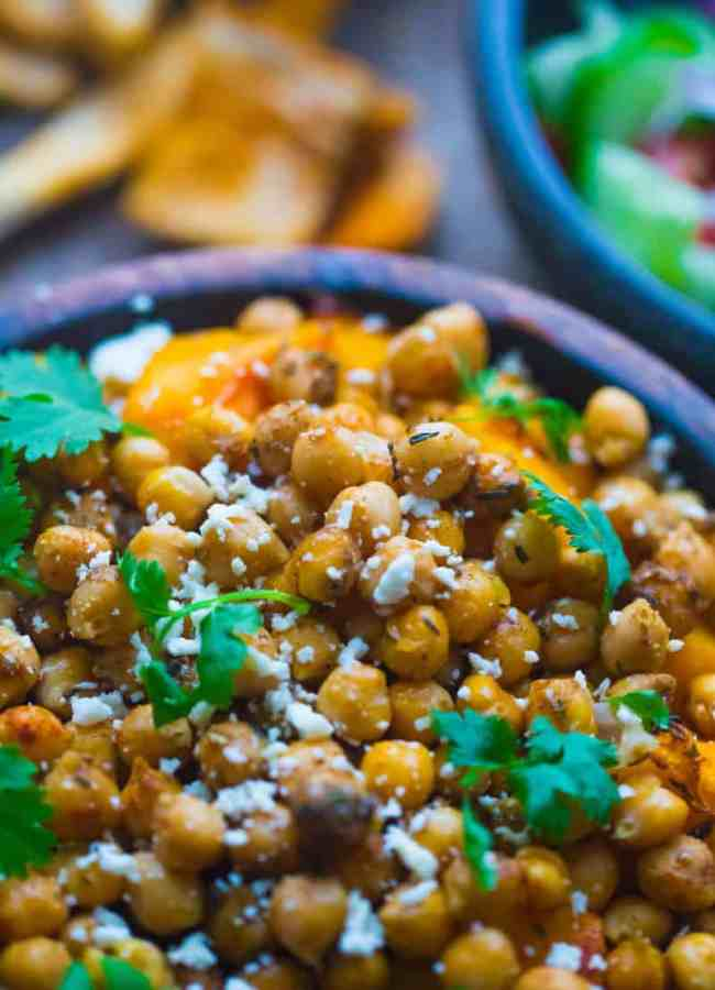 Butternut Squash and Chickpea Salad with feta and coriander in wooden bowl