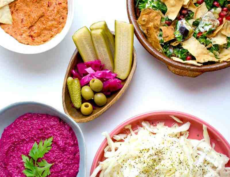 Muhammara, Pickles and Veg Platter on table