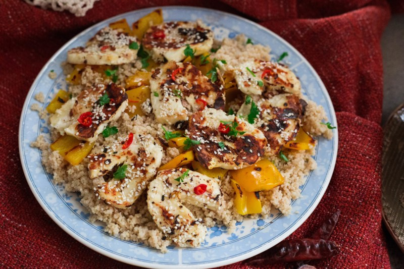 Halloumi and Cous Cous Salad in plate on a throw