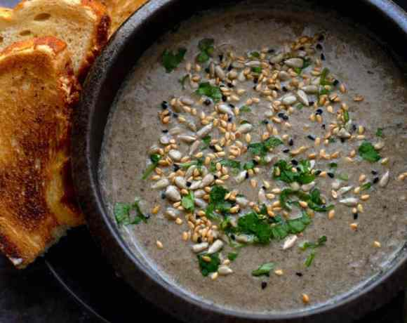 Cream of Mushroom Soup with Tarragon topped with seeds, with toast