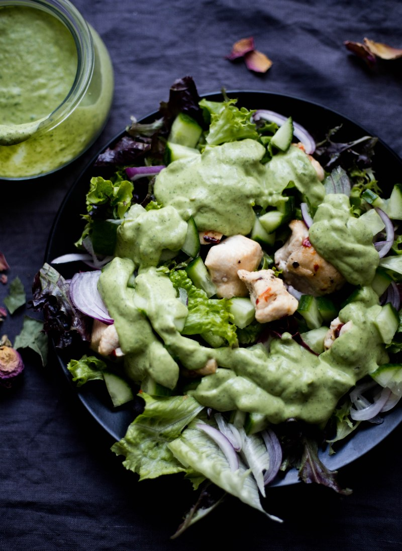 Indian Chicken Salad with Avocado Green Chutney Dressing on black plate