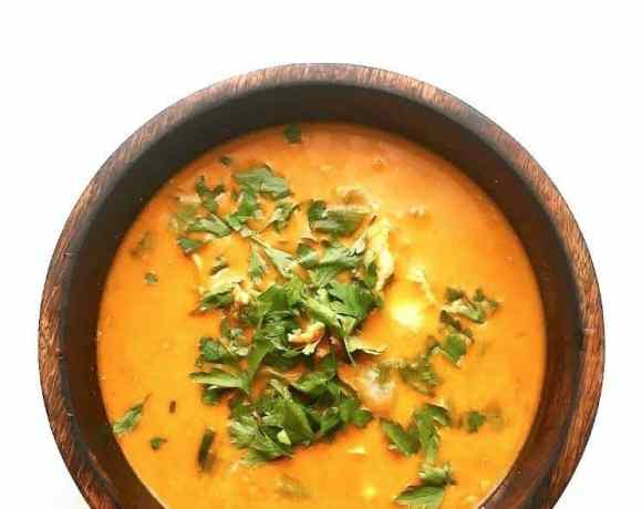 Thai Soup in wooden bowl topped with coriander