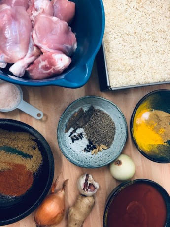 Ingredients for Chicken Akni on a table