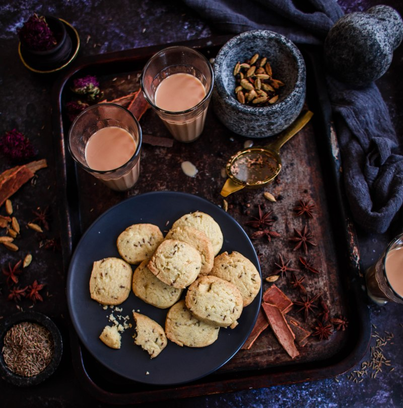 Cumin Biscuits and Masala Chai and spices on a tray