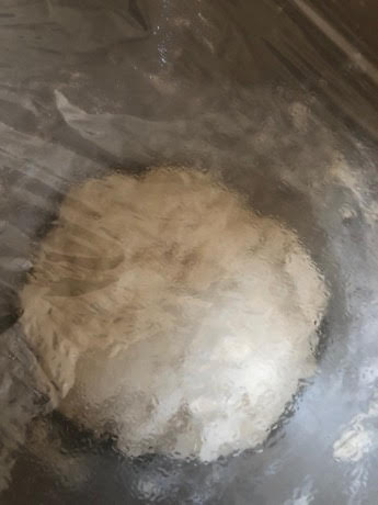 Dough in bowl with cling film on top